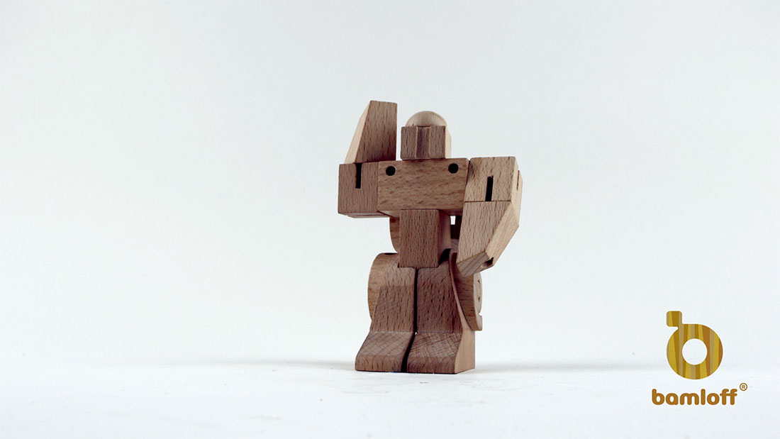 Kickstarter video stop motion animation of wooden toy car transforming into a robot for crowdfunding campaign page